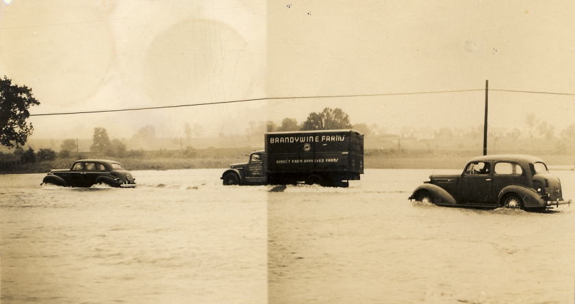 Cars and a truck navigate the Lincoln Highway during a flood in Exton, PA